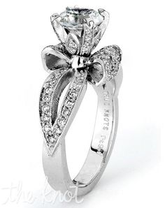 Reminiscent of sheer femininity, THE KNOT engagement ring collection is sensual and inspired by the warmth of an embrace. Shown in platinum, this engagement ring sparkles with 0.51 cttw of round diamonds and is sure to win her heart. Matching wedding ring is available. Center can accommodate any shape and size stone. (Center is not included). Available in Platinum and Gold.