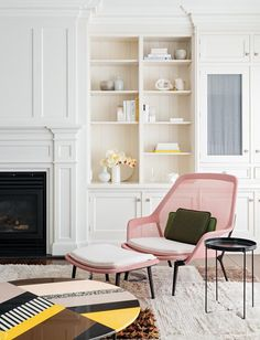 Feminine modern living room with blush pink chair