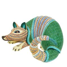 Absolutely spectacular armadillo by David and Ivonne Hernandez.  This fabulous piece is carved so esthetically, it is fluid, symmetric, well balanced and projects a sense of alertness. The painting is exquisite. It is clean, precise,harmonic and complements the form and design of this wonderful sculpture. The coloring ...just perfect.  This is definitely one of the most beautiful armadillos I have seen.