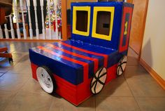 Thomas the Train! Cardboard box, paper plates, & colorful duct tape.