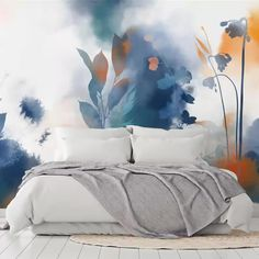 This watercolour art is the perfect feature wall for a calming bedroom. From blue flowers growing from the ground, to bright red blooms and yellow leaves, there are colours for everyone to feel uplifted by these gorgeous wallpaper murals. Style with a simple bed with no headboard and neutral white and grey bedding with minimal colour. Shop now at Wallsauce.com!