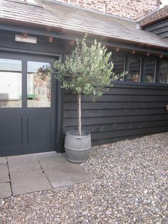 love the black cladding and door  baileys home + garden  photo by tricia foley