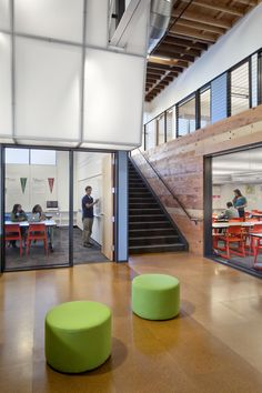 Staircase from the main reading room lead up to the second level tutoring and multipurpose rooms - College Track San Francisco, Turnbull Griffin Haesloop Architects