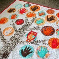 Family Tree Quilt Use a handprint from each family member to create this amazing family tree quilt. It's the perfect gift to celebrate your family.