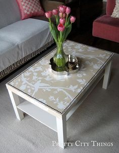 Coffee table + wallpaper + glue + nail heads =  coffee table makeover ... brilliant! this is happening immediately