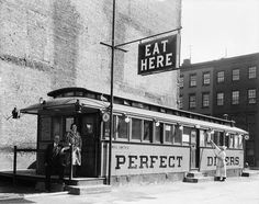 ROOF TOP DINING: Dining car or lunch wagon on downtown New York City loft, photograph taken in 1920.