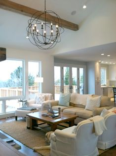 Living Room with Large Windows, Natural Light, Comfy Furnishings and Home Decor.