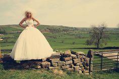 13-stone-wall-bride-green-fields-england-wedding-dress