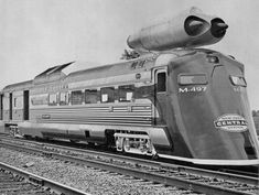 """The New York Central """"High-speed"""" railcar M-497, put together by the NYC Railroad in 1966. This first """"High-speed"""" railcar, was a 13 year old Budd RDC (rail diesel car) that had once run in the Boston and Albany Beeliner Fleet. The diesel engines were disconnected and 2 GE J-47 turbojet aircraft engines were mounted on the roof. The car had a streamlined front, and special cylindrical tread wheels were installed. New York Central Railroad Publicity Photo."""