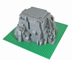 We've all seen some nice LEGO rocks built for castles to sit on top of. - We've all seen some nice LEGO rocks built for castles to sit on top of. Don't you want to build - Lego Design, Lego Disney, Lego Sets, Halloween Lego, Lego Poster, Box Container, Lego Sculptures, Micro Lego, Lego Blocks