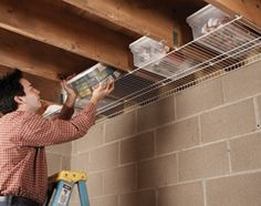 Wire shelf under basement rafters - brilliant