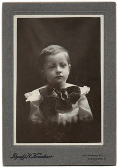 This is a very sweet cabinet photo of a little boy with a great big bow. Its approximately 5 x 7 and dates from around 1890 - 1900. Its from