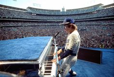 Terry O'Neill's iconic photo celebrates Elton's shows October 25 and 26, 1975, at Dodger Stadium in Los Angeles - the first time a rock act had played there since The Beatles in 1966. These two shows saw Elton play in front of 55,000 people each night, and remain some of the most famous concerts he has ever given