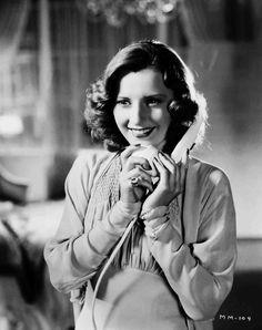 The Mad Miss Manton (1938), starring Barbara Stanwyck. Medium shot of Barbara Stanwyck as Melsa Manton speaking on telephone.