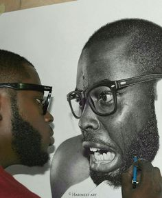 Nigerian artist Arinze Stanley, stands out from any other hyperrealistic art. His drawings, each painstakingly rendered with charcoal and graphite pencils, look like the portraits of a master photographer working in the black-and-white medium.