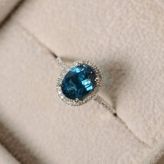 This ring features a 7mm*9mm oval cut genuine London blue topaz and sterling silver finished with rhodium. Customization is available. It is made by hand, and it will take about 7 days to finish the ring after your payment is completed. Main stone: London blue topaz London blue topaz weight: Approx 2.00 ct Metal type: sterling silver finished with rhodium Accent stone: cz Customization is available, I also can make it with 14k solid gold (white or yellow or rose) and diamond accent stone…
