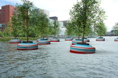 "The artists, sculptur Jorge Bakker, and the project team hope that the 'Bobbing Forest' in the Rijnhaven of Rotterdam, the Netherlands, raise questions about the relationship between nature and city dwellers, such as ""What expectations do city dwellers have in connection to planting and vegetation? And... can they relate to the green world around them?"""