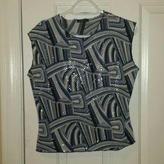 Fun blue patterned top Blue patterned short sleeve top. Has little glitter like circles that are shiny all over it. No size listed, but fits like medium. Jaipur Tops