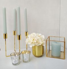 Scandi style gold candelabra, gold pot, mercury votives and gold glass box to hire from Moi Decor Hire
