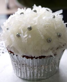 chocolate cupcake covered with Seven Minute Frosting and topped with sweetened coconut flakes   chocolate cupcakes