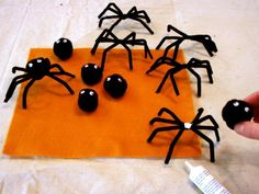 Halloween Napkin Rings Feature Pipe Cleaner Spiders Glued Together Halloween Dinner, Holidays Halloween, Halloween Crafts, Halloween Stuff, Diy Halloween Decorations, Halloween Themes, Fabric Pen, Fabric Glue, Doors