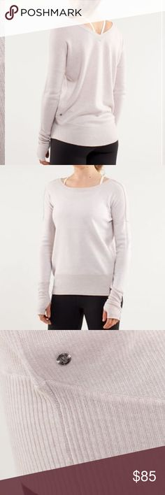 """Lululemon Yin Me Reversible Pullover Sweater Beautiful Lululemon Yin Me reversible pullover sweater in heathered dune/ white. Features extra long arms with thumb holes.  Metal Lululemon symbol on both sides.  Can wear scoop neck or v-neck in front or back.  Fits like a 6, but no size tag so check measurements.  Chest is 42"""" and length in front is 22"""" and back is 24"""" (depending how you wear it).  In excellent condition. lululemon athletica Sweaters"""
