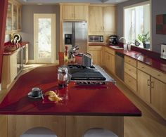 This is a great example of Maple Cabinetry with Red Quartz counter tops. Description from delormedesigns.blogspot.com. I searched for this on bing.com/images