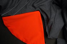 #RMIT #CreativeFest Jenni Thorman Drunken Tailor/Tailored Cycling Jacket.  BP194 Bachelor of Design (Fashion) (honours) -Tailored wool jacket -Wicked lining, draws moister away from the body -Snap magnetic closures -Both cuff and collar fold to reveal reflective surfaces.  -Inside welt pockets X 2, specifically designed for MP3 player and includes hands free cable tabs.  -Back: Air vents allow movement across the shoulders -Reversible and removable splash back panel -Reflective piping all…