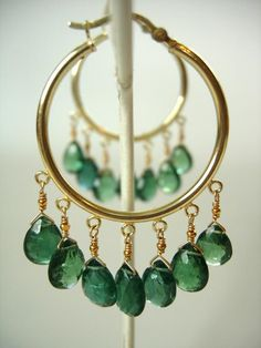 nile green apatite briolettes dripping from 14k gold fill hoops, adove fine jewelry.