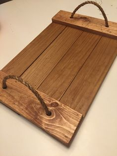 Custom, hand-crafted wood serving tray with natural fiber rope handles. Dimensions are approximately 21 x 14 inches. Custom sizes and Diy Wood Stain, Walnut Stain, Serving Tray Decor, Bois Diy, Scrap Wood Projects, Diy Pallet Furniture, Wood Tray, Wooden Crafts, Wood Pallets