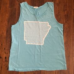 •Arkansas• State Love Comfort Colors Tank Arkansas state love! Turquoise blue (a little brighter than shown in photos) comfort colors tank size M. No stains or tears. Only worn 1-2 times. Tops Tank Tops