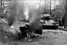 APR  23 1945 Seventeen year olds hold defences in burning Berlin - See more at: http://ww2today.com/T-34-85 tanks of the 7th Guards Tank Corps in the suburbs of Berlin. In the foreground is the burning skeleton of a German car.