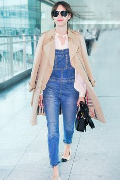 15 Celebs Who Rule At Travel Style #refinery29  http://www.refinery29.com/58879#slide3  Alexa Chung is a sartorial whiz everywhere else, so of course airports are no exception. Overalls, a button-down top, flats, and a crisp trench that's caped perfectly over her shoulders — we'd copy this comfy, casual outfit whether we're jet-setting or not.