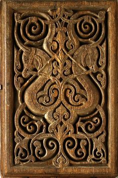 11th Century Egyptian wooded panel carved with horse heads