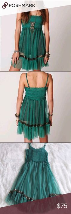 Free People One Sequin Smocked Slip Dress Free People One Sequin Smocked Slip Dress in Emerald Green. Sheer, gauzy layering slip with sweet ruffled bottom accented with sequins. Stretchy material. Great pre-owned condition. Free People Dresses Mini