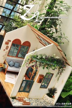 .Just the picture, but wow, what a dollhouse! I love the greenery outside on the wall.