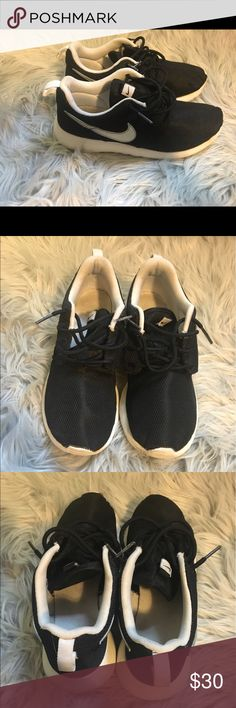 Black Roshe run I'm good condition.. Only flaw is last picture, front of the shoe is coming up a little but could be easily glued back down, Size 4.5y Nike Shoes Sneakers