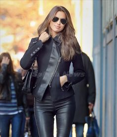 Russian Model Irina Shayk was spotted looking sexy in leather as she walked through the streets of New York City. The Sports Illustrated swimsuit model appeared to be all smiles as she strutted along in her sleek leather jacket and black leather pants with boots. Earlier in the week the model attended a sportswear launch in a short dress that also showcased her enviable long legs.
