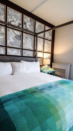 This Modern Irish hotel is set next to the Atlantic Ocean; the interior design combines modern with rustic traditional decor ideas.  While the architecture of the reception is rustic with details found in a country cottage or farmhouse. The natural seaside setting inspires the bedrooms and suites colours.   | #bed | #blanket | #headboard |