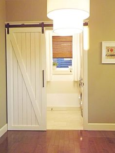 love the barn door! Bre, would this work for your laundry room? It is so cool and would look neat in your house.