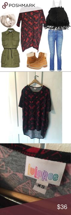 LULAROE Black And Red Tribal Pattern Irma Tunic So many possibilities with the Irma! Long enough to wear as a minidress or as a Tunic with leggings, or knot the size to make a cute shirt! This is a size XS but very roomy so really more of a one size fits all, depending on how you want it to look! Very minor lint/fading visible in close up picture. No holes or obvious flaws. Worn/washed only a couple times. Hard to find pattern! It's Lularoe so you know it's the most comfortable material…