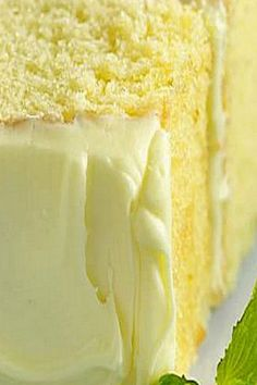"""Lemon Drop Cake - """"poked"""" with a fork and pouring sweetened lemon juice over this cake is a delicious secret ingredient!"""
