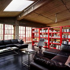 now this is where it's at.  dark colors. space. loft. natural light. wonder how the maintenance is on the black floor.