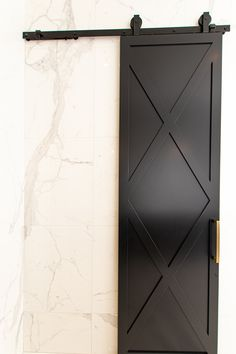 Unique narrow black foor with iron black and gold hardware, perfet for a bathroom. Dark Furniture, Living Room Furniture, Barn Doors, Garage Doors, Custom Interior Doors, Contemporary, Modern, Gold Hardware, Projects To Try