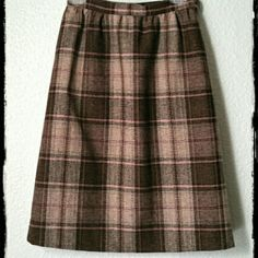 "Vintage Brown & Pink Plaid Skirt Slightly flared, lined plaid skirt is homemade by me in the late 70s. I believe it's a wool blend fabric. Waistband has a side zipper and button closure. Measures: waist 26"", width of hem 47"", length 25"". Homemade Skirts A-Line or Full"