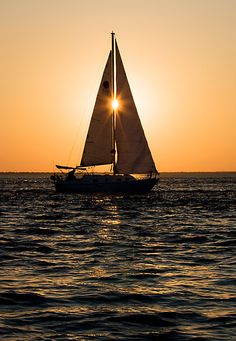 Solar Line Up by Janet Fikar.  A local sailboat crossing the sunset.  Choctawhatchee Bay, Florida. This one I had to wait for to line up exactly.