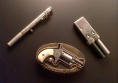 Small hidden guns confiscated by the Bureau of Alcohol, Tobacco, and Firearms included a modified belt buckle gun and a cigarette lighter pistol.