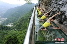 Yoga fans performed yoga on a cliff road at Qingjiang Fangshan Scenic Spot in Yichang, C China's Hubei, via TW by People's Daily, China