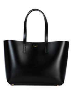 Shop designer tote bags for women at Farfetch for of designs from your favourite designer brands. Black Leather Tote Bag, Black Leather Handbags, Leather Pouch, Saint Laurent Tote, Tote Handbags, Tote Bags, Tote Purse, Black Purses, Shoes