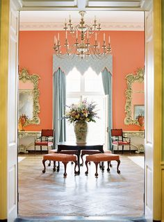 love this wall color with the blue curtains... maybe dining room?